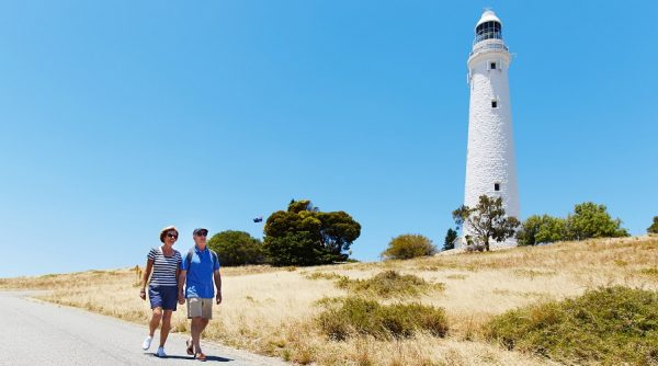 Couple walking near the Wadjemup Lighthouse, Rottnest Island. Please note: Image must be used for Rottnest Island destination only.